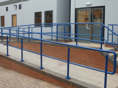 Blue ramp and step handrails with mid-rail in Coventry, West Midlands. Manufactured and installed by Eagledale.
