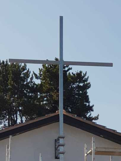 Stainless steel cross on a church in Coventry. Manufactured and installed by Eagledale Architectural Metalwork.